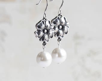 White Pearl Earrings with Antiqued Silver Flower Dangles on Silver Plated Hooks