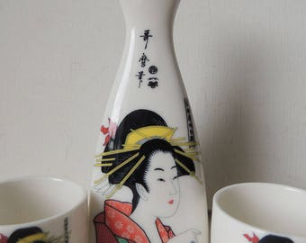 Sake Set in the Ukito-e Style Japanese Porcelain Decanter and 4 cups