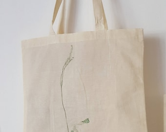 Boho botanical hand-printed cotton tote bag with long handles.  Floral pattern: lavender flower and dried berries in soft green hues.