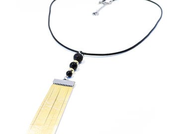 Necklace made with golden leather, stones and inox. Women necklace