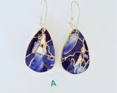 blue and white dangle earrings in porcelain and gold