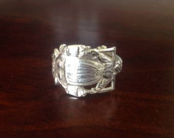 Woman carrying water teaspoon ring