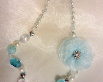 Child necklace. Aqua blue and white.