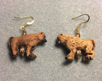 Light brown ceramic baboon bead earrings adorned with light brown Czech glass beads.
