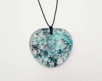 Blue heart glass pendant, cast from transparent, blue & black glass.