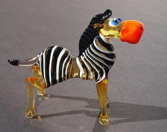 Glass Zebra. Detailed whimsical figurine with a lot of personality.  Excellent addition to  glass  collection.