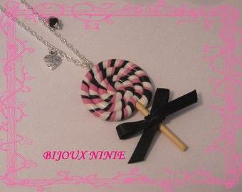 Rolled rose and black polymer clay lollipop necklace