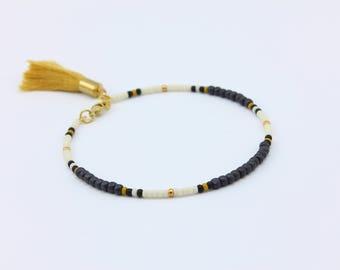 African Inspired Seed Bead Friendship Bracelet with Mustard Tassel, Handmade Jewelry by Detail London.