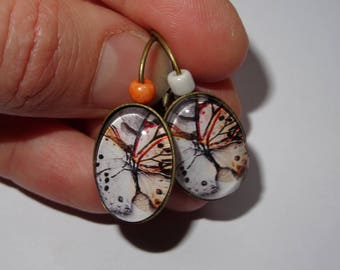 Butterfly earrings in shades of white and Red
