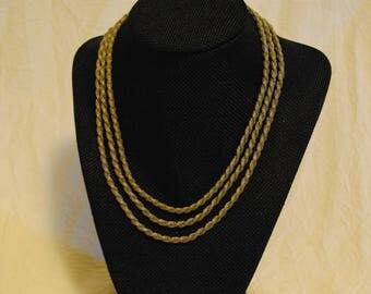 Three strand twisted silver colored chain necklace