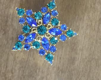 Golden blue star broche