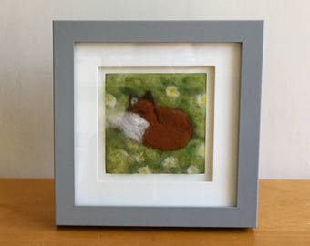 Fox sleeping in a daisy field 2d needle felt art. Delightful picture of a sleeping fox in a grey painted frame