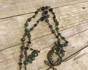 Blue, black, and antiqued brass owl becklace