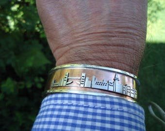 Bracelet in silver and copper with your favorite city skyline. Pure handmade.