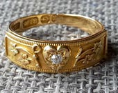 This is a very rare antique 18ct gold diamond secret Dearest love ring hallmarked Birmingham 1897