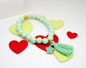 Fancy bracelet glass beads Mint green, Golden Pearl, flower and tassel charm