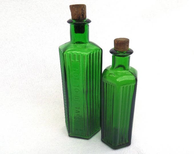"Antique Apothecary Bottles, Pair of Emerald Green Glass Poison Bottles, Original Cork Stoppers, Circa 1900 ""Not To Be Taken"" Embossed"