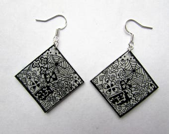 black and white squares with fine patterns