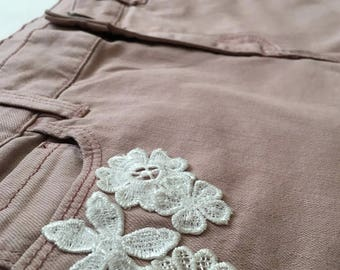 light pink jean skirt with flower patches
