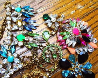 Rhinestone repair lot for crafting and jewelry making. An assortment  of different shapes and colors
