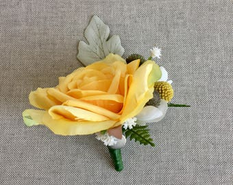 A yellow Rose buttonhole