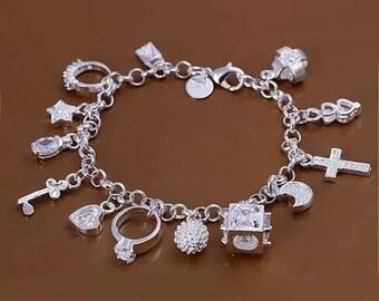 A women 925 sterling silver plated charm bracelet