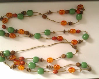 long orange, green and wood bead necklace