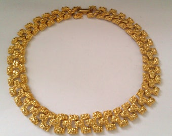 gold coloured choker/necklace