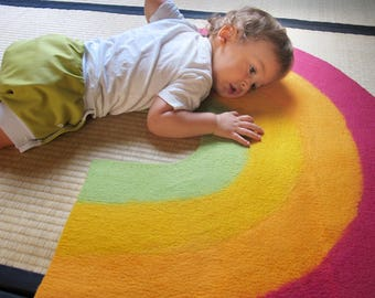Felted wool Rainbow carpet made in france, wet felt carpet for children.