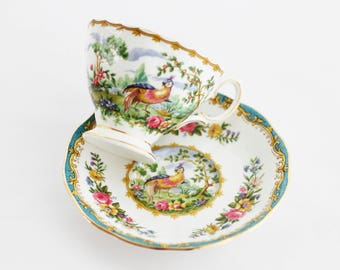 "Royal Albert's ""Chelsea Bird"" teacup and saucer, lovely aqua/turquoise colored edges, gold gilt rim, made in England"