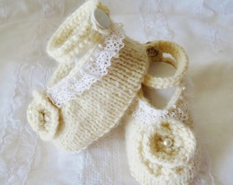 small cream colored baby shoes made by hand