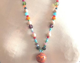 beaded necklace multicolored beads and pink tassel