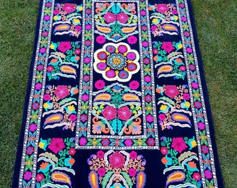 Uzbek Big Great Garden of Wisdom suzani as a bed cover