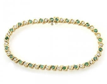 1.75 Carat Round Cut Emerald Tennis Bracelet With 0.65 Carat Round Cut Diamonds 14K Yellow Gold