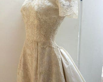 Totally stunning vintage wedding dress from early 60's, has a very 50's look, amazing champagne corded lace, spectacular train, small size.