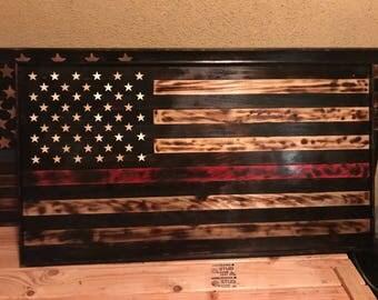 American flag, burnt wood