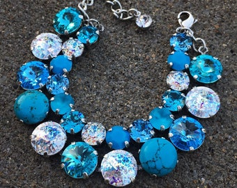 TURQUOISE DREAM Swarovski crystal double stranded bracelet with turquoise cabochon, turquoise, aquamarine, &white patina in antique silver