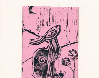 lino cut print hare in pink