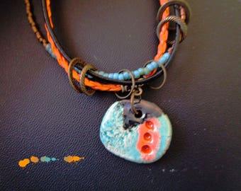 Orange leather, beads, turquoise ceramic pendant necklace.