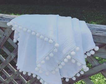 White pom pom swaddle blanket 100% cotton