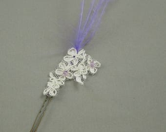 Lace hair picks and purple bead for the bride.