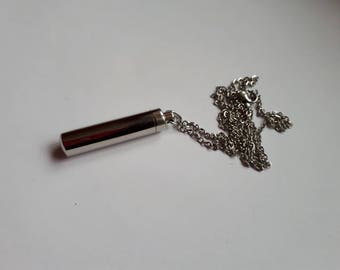 Small Secret screw steel vile locket on silver chain
