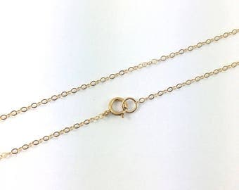 Delicate chain goldfilled (14 k) length 20 inches (51 cm) with a buoy