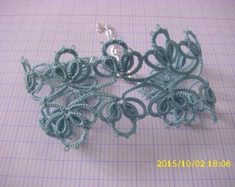 This bracelet is hand tatted lace light blue
