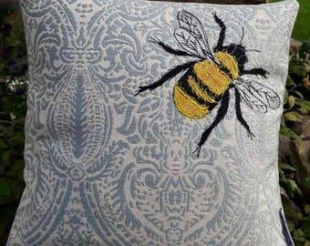 Handmade bumble bee cushion