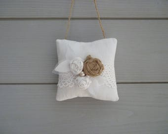 Worn white fabric shabby bouquet of roses and lace pillow