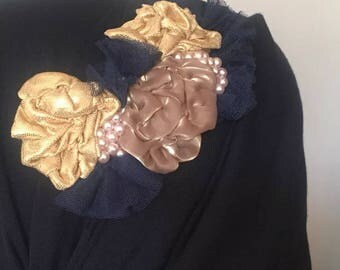 Navy and gold hijab accessory/headpiece.