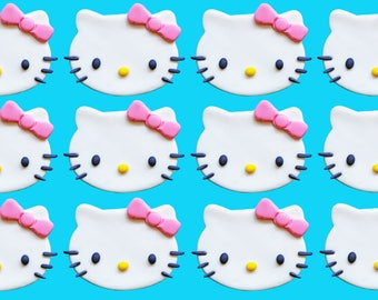 12 fondant Hello Kitty cupcake toppers. Colors can be customized.