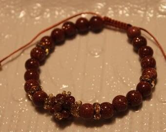Beautiful gold stone-beaded handmade bracelet; beadweaving, shamballa, goldstone, elegant, golden color