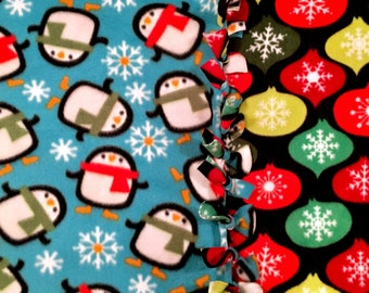 Penguins in a Winter Wonderland! Holiday Fleece Blanket designed by JAX. A pengin themed throw that makes holiday gifting & decorating easy.